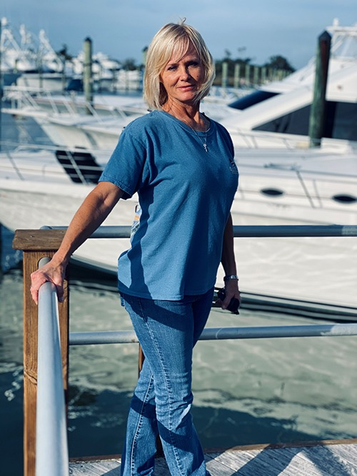 <b>Cathy DiMauro - Owner/Designer/Project Manager</b><br/> During a career in the yachting industry that spans over 27 years, Crystal Coast Interiors Owner Cathy DiMauro has established a reputation for building solid relationships with her clients. Growing up with a passion and fascination for boats, she has worked and played hard in the waters of the Crystal Coast. After working for a local boat builder for a few years, Cathy began heading up a crew of 14 and was responsible for the interior and exterior wood finishing and finial detail on new construction. Later she went back to school to study interior design and realized with the shift from charter boat to sport fishing yachts, that the clientele needed a designer to help with their selections. With her attention to detail and knowledge of space planning, Cathy maintains the daily functionality of a boat while creating stunning custom interiors.